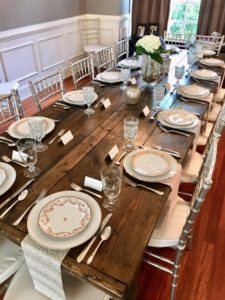 Beautiful farmhouse table by Presentime Rentals and mix matched china by The Prissy Plate Company. Florals by In An Instant, LLC.